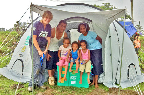 Saule and Usenia and their children outside their new home with SRT member Sally Fletcher (NZ), April 2012.