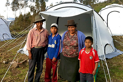 image of Lazaro, Eulalia and their two children outside their new home, April 2012.