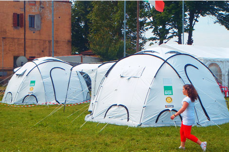 ShelterBox tents set up on a football pitch bringing shelter to families made homeless by the disaster in San Felice.