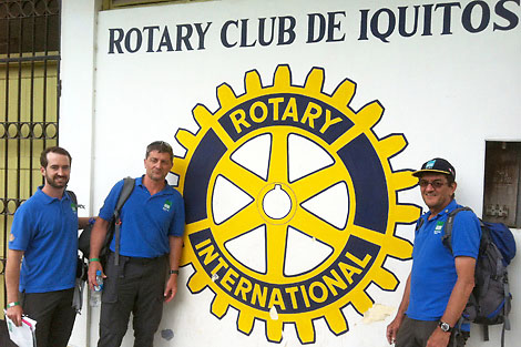 Photo of SRT volunteers Alan Monroe (US), Bruce Heller (US) and Derek Locke (US) outside Iquitos Rotary Club, Peru, May 2012