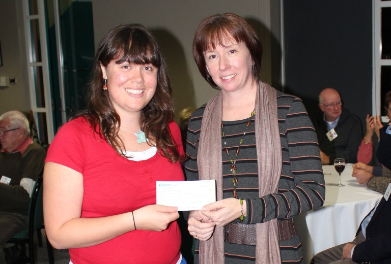 Lara Marks-Nash is presented with a cheque by Nelson Bay Rotarian and SRT, Lynn Jarman