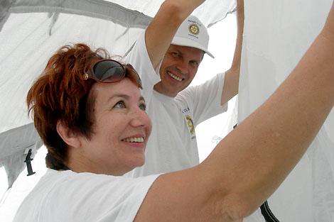 Rotarians Fedor Gladkiy and Nadezhda Smirnova helping set up the tents, July 2012.