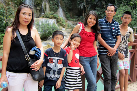 Tiffany Stephenson with her family at some waterfalls in Luangprabang, Laos, where her family is from. From left to right: her cousin, Sinh; her cousin, Pom's son, Simon; another cousin's child, Minh; Tiffany; cousin, Pom; Sinh's son, Wave.