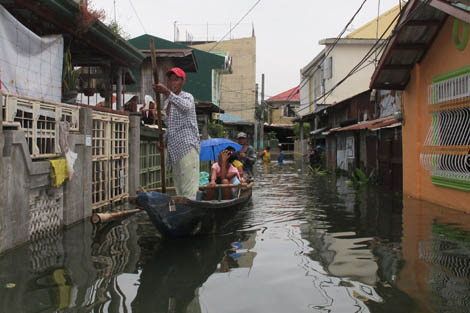 Flooding the streets of the capital, Manila