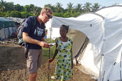 SRT member Jeff Pietras talking with Nalise Noel about her experience living in a ShelterBox tent, August 2012