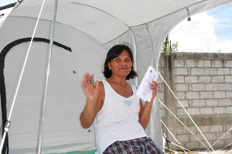 Myrna Urot outside her new ShelterBox tent in the Philippines, August 2012.