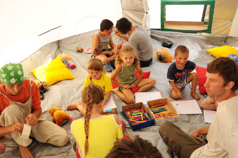 Children from the camp settlement playing in a ShelterBox tent set up for the nursery, Russia, July 2012.