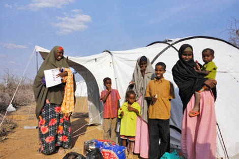 Displaced family in a ShelterBox tent in Dadaab, Kenya, following ShelterBox's response to drought, famine and conflict in August 2011