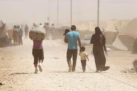 Photograph taken by Reuters/Ali Jarekji, courtesy of the Thomson Reuters Foundation – AlertNet. Syrian refugees arrive at the Al Zaatri refugee camp in the Jordanian city of Mafraq, near the border with Syria August 29, 2012.