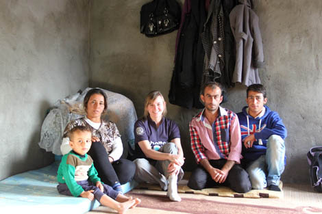 From left to right: Abdullah's Auntie Nayima (30) and her three-year-old son Azadin, SRT member Rebecca Novell (UK), Abdullah (28) , Mohammad (15), all at Abdullah's temporary home he built at Domiz refugee camp, November 2012