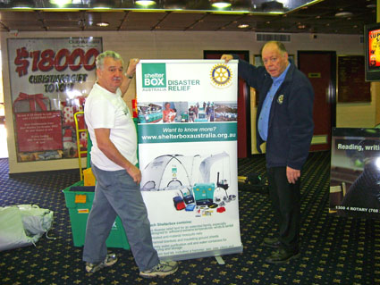9790 District Governor John Gatt (one of our strong supporters) assists Shelter Box District Rep Alan Jones in erecting the Shelter Box display.