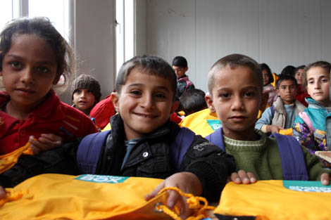Syrian refugee children happy with their ShelterBox school stationery packs, Domiz refugee camp, Iraq Kurdistan, November 2012.