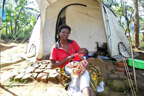 Grace Mutuwa with her baby boy Bob who she gave birth to in her ShelterBox tent, Bududa, Eastern Uganda, November 2012.