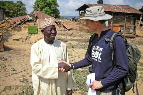 SRT member Jan Larsson (SE) talking with village leader in Nigeria, December 2012.