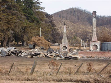 Only the stone chimneys of this property are left standing