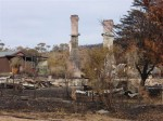 Only the stone chimneys are left standing at this property