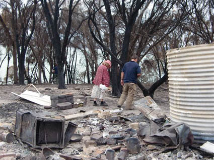 SRT Scott Jarman (AU) is shown around the ruins of this lay's home