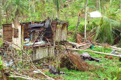 The first ShelterBox tent set up on 24 December 2012 in Compostela Valley at the Municipality of Monkayo in Township Banlag. The family will be able to rebuild their home whilst living in comfort and shelter.