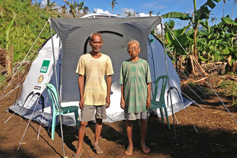 Jose and Protacia Ongcoy, a married couple in their late seventies who lost everything to Typhoon Bopha at the beginning of December in front of their new shelter, Philippines, January 2013.