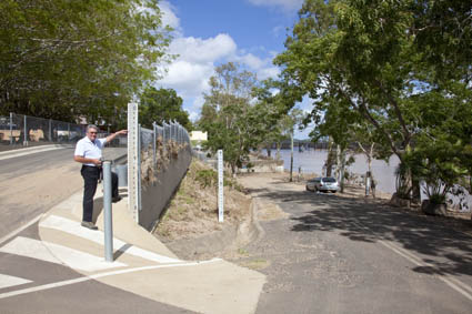 Bundaberg Sunrise Rotarian, Tom Head indicates the height of the flood at 9.5m