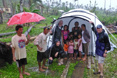 SRT members Bill Woodard (left), Sonny Ongkiko (crouching), John Cordell (right) with Eric and Evelyn Nono and their five young children, Philippines, January 2013.