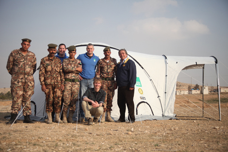 SRT members Ian Neal (UK) and Stafford Sumner (UK) with ShelterBox's Audio-Visual Officer John Jones and the border guards in Jordan at the Syria border, February 2013.