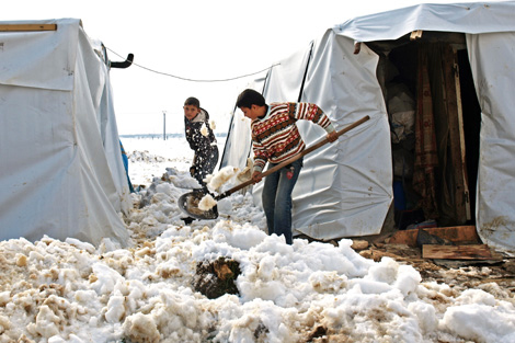 Syrian refugee families living in makeshift shelters in the Bekaa Valley as winter conditions continue, Lebanon, January 2013. Photo by Raphael Thelen.