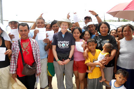 SRT member Liz Odell (UK) with ShelterBox beneficiaries in Baganga, Mindanao Island, Philippines, February 2013.
