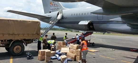 (RNZAF Boeing 757 being unloaded at Honiara Airport, Solomon Islands)