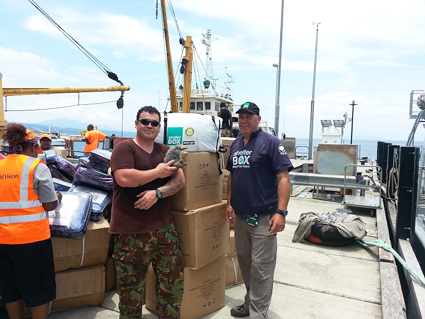 "ShelterBox SRT Lyndon Tamblyn and ""Kiwi"" colleagues loading ShelterBox tents"