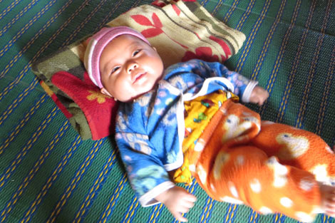 Two-month-old Sitnoupan who was born in a communal shelter, Myanmar, March 2013.