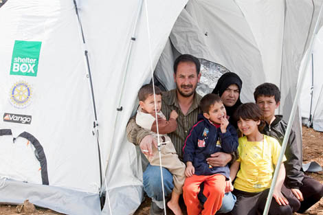 Bassam Shebab, his wife and family with their ShelterBox tent, Lebanon, March 2013. ©MikeGreenslade/ShelterBox