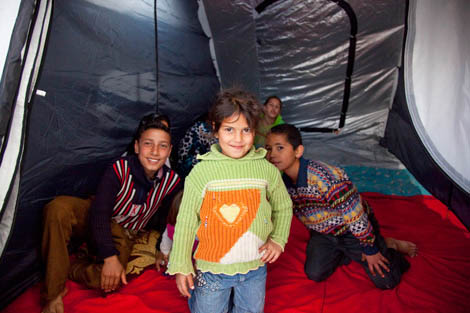 Happy Syrian children in their ShelterBox tent, El Minie, Lebanon ©MIkeGreenslade/ShelterBox