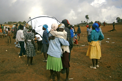 Families move into ShelterBox tents in Haiti.