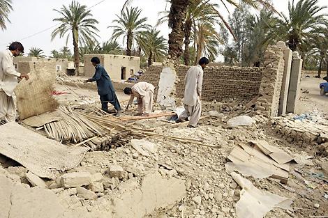 Photo coutersy of Balochistan Rural Support Programme (BRSP). Quake survivors helping clear up rubble, Mashail, Pakistan, April 2013.