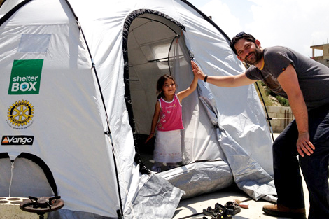 SRT member Jon Levine (UK) with Syrian child in Akroum, May 2013.