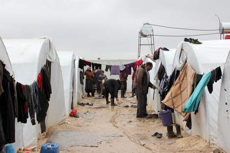 Photo courtesy of Relief International. Internally displaced Syrian families living at Al-Salameh camp in Syria in tents provided for them by the camp management authorities, December 2012.