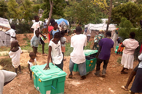 ShelterBoxes being distributed to families in need in Haiti three years on as part of IOM's return to home scheme, April 2013.