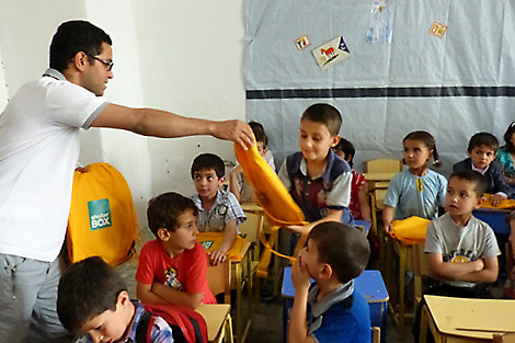 ShelterBox's implementing partner Hand in Hand for Syria distributing children activity packs to affected children in southern Idlib, Syria, June 2013.