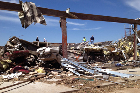 Debris being cleared that was left behind by the tornadoes' destruction in Oklahoma, USA, May 2013.