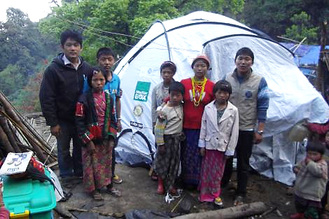 Daw Kaw's family with their new ShelterBox tent, Myanmar, July 2013.