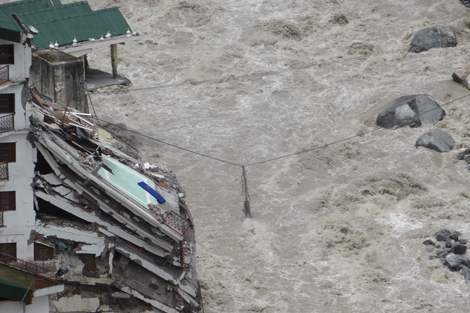 Heavy monsoon rains bring widespread flooding in the Himalayas, India, June 2013.