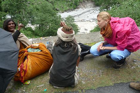SRT member Eva Doerr (DE) speaking with pilgrims who experienced the flooding, India, June 2013.