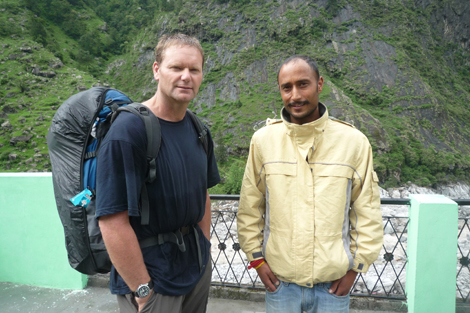 SRT member Mike Peachey (NZ) with Asish, a local from Pandukeshwar, who is hosting his friend whose hotel was washed away by the floods, India, June 2013.