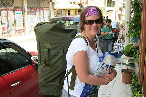 SRT member Rebecca Swist (DE) holding a LifeStraw, a water filter that is part of the ShelterBox contents, June 2013.