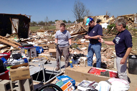 ShelterBox Response Team (SRT) member Wayne Robinson (US) assessing the need with members of the local affected community, USA, June 2013.
