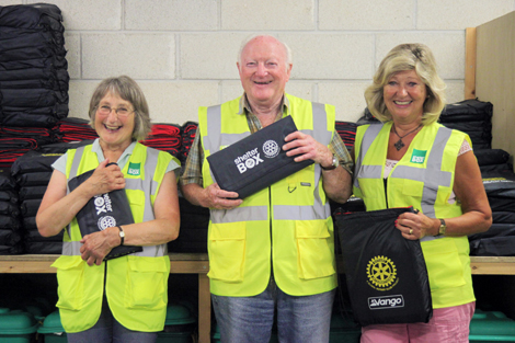 From left to right: ShelterBox volunteers Carol Raines, Alec Parker and Ann Carter who assisted with the Lebanon box pack at ShelterBox headquarters, UK, August 2013.