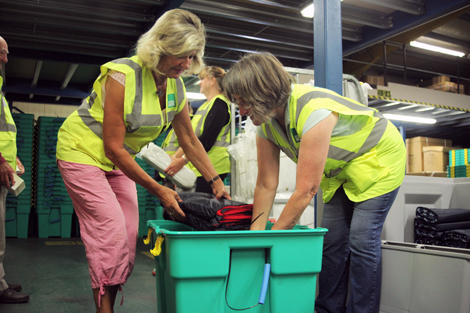 Ann and Carol packing a winterised ShelterBox heading for Lebanon in the ShelterBox warehouse, UK, August 2013.