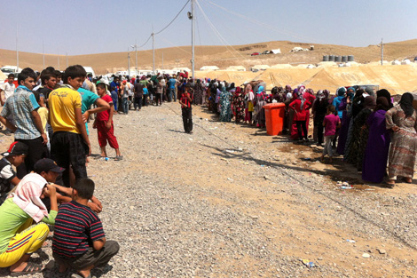 Syrian refugees queuing for food at Krwigorsk camp, near Irbil, Iraqi Kurdistan, August 2013.