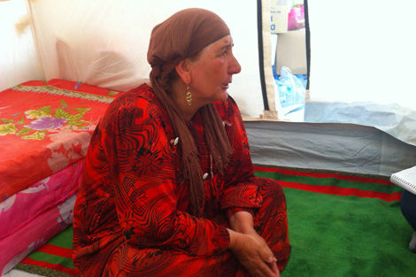Qadria sitting in her United Nations shelter at Krwigorsk refugee camp, August 2013.